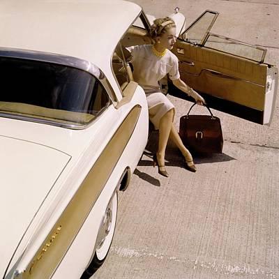 Cross Legged Photograph - Model Sitting In A 1958 Packard Hawk by Karen Radkai