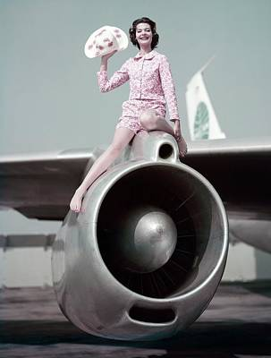 Model Sitting On An Airplane Engine Art Print by Sante Forlano