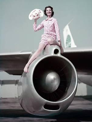 Model Sitting On An Airplane Engine Art Print