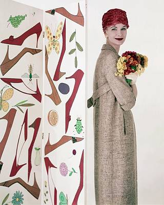 Suzuki Photograph - Model Sunny Harnett Holding Flowers by Karen Radkai
