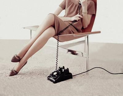 Cross Legged Photograph - Model Talking On A Telephone by Karen Radkai