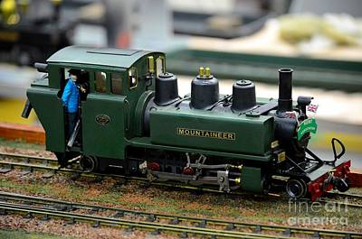 Model Train Green Steam Railway Engine With Driver In Cab Art Print by Imran Ahmed
