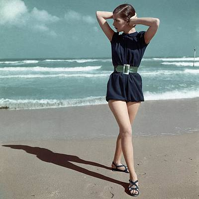 1940s Fashion Photograph - Model Wearing A Blue Swimsuit On A Beach by Serge Balkin