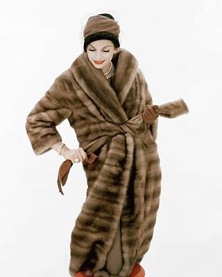 Photograph - Model Wearing A Fur Coat And Hat By Lilly Dache by Henry Clarke
