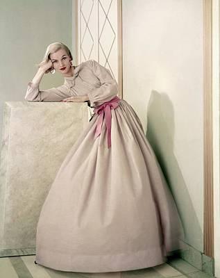 Model Wearing A Pink Shirt And Full Skirt Art Print