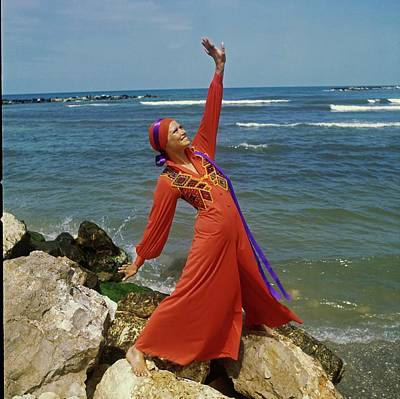 Photograph - Model Wearing A Red Jump Suit by John Cowan