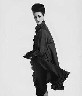 Adele Photograph - Model Wearing Ruffled Raincoat by Karen Radkai