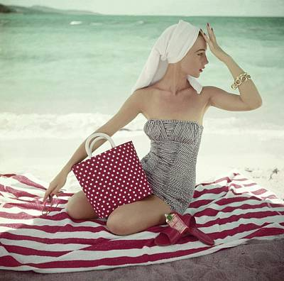 1950s Fashion Photograph - Model With A Polka Dot Bag On A Beach by Roger Prigent
