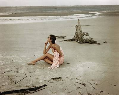 People On Beach Wall Art - Photograph - Model Wrapped In A Pink Towel On The Beach by Frances McLaughlin-Gill