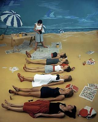 Photograph - Models Lying On A Fake Beach Set At A Studio by Serge Balkin