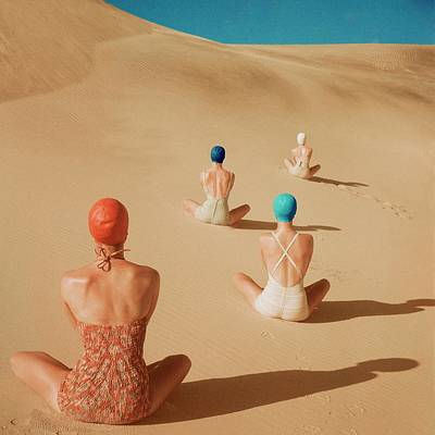 Swimming Photograph - Models Sitting On Sand Dunes by Clifford Coffin