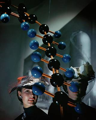 Photograph - Models Wearing Hats With A Molecular Model by John Rawlings