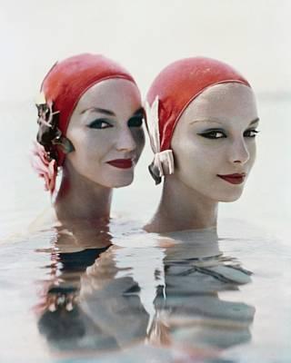 Eyeliner Photograph - Models Wearing Pink Bathing Caps by Richard Rutledge