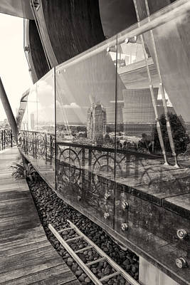 Photograph - Modern Buildings Reflecting In The Facade Of A Glass Building by Francesco Rizzato