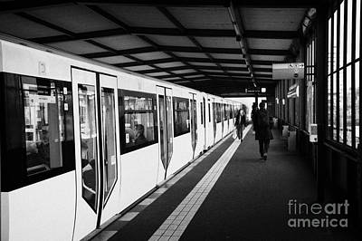 modern yellow u-bahn train sitting at station platform Berlin Germany Art Print
