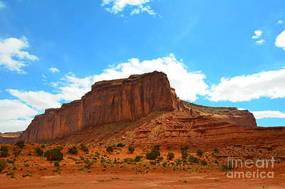 Photograph - Monument Valley Rock Formation And Clouds by Debra Thompson