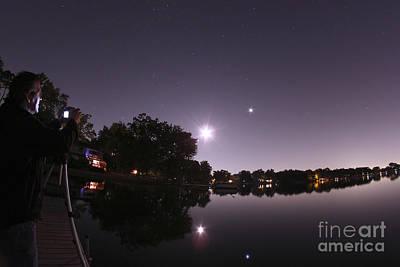 Amateur Astronomy Photograph - Moon And Jupiter Over Lake by John Chumack