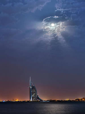 Moonlit Night Photograph - Moon Over Burj Al Arab Hotel by Babak Tafreshi