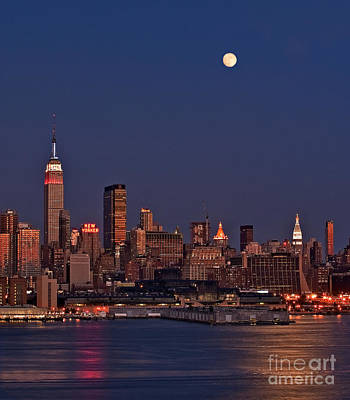 Moon Rise Over Manhattan Art Print by Susan Candelario