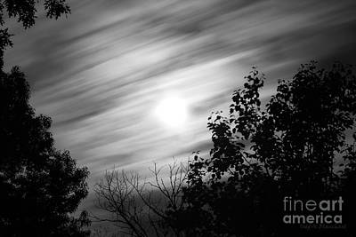 Photograph - Moonlit Clouds by Todd Blanchard