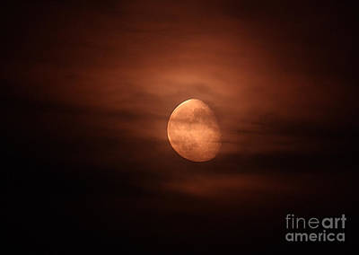 Waning Gibbous Moon Photograph - Moonrise Through Clouds by John Chumack