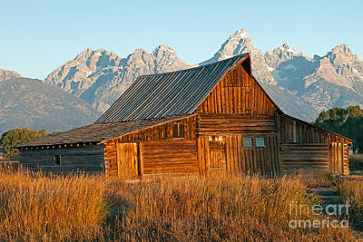 Photograph - Mormon Row Barn The Tetons Grand Teton National Park by Fred Stearns