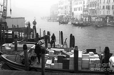 Artist Working Photograph - Morning Delivery In Venice by John Rizzuto