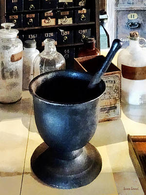 Mortar And Pestle Near Medicine Bottles Art Print by Susan Savad