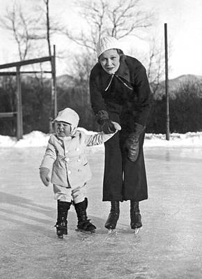 Mother & Daughter Ice Skating Art Print by Underwood Archives