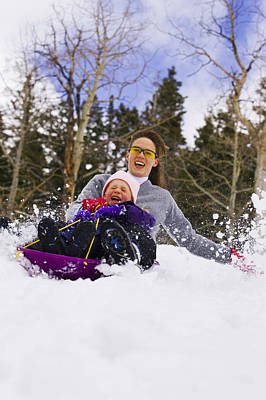 Mother & Daughter Sledding Together Art Print by Michael DeYoung