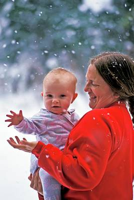 Woman Holding Baby Photograph - Mother And Baby In Snow by Jim West