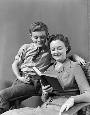 Preteen Photograph - Mother And Son Reading, C.1930-40s by H. Armstrong Roberts/ClassicStock