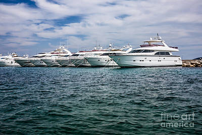 Giuseppe Cristiano Royalty Free Images - Motor yachts in the harbour Royalty-Free Image by Tomislav Zivkovic