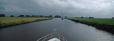 Friesland Photograph - Motorboat In A Canal, Friesland by Panoramic Images