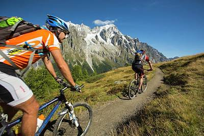 Saxe Photograph - Mountain Bikers On Mont De La Saxe by Ashley Cooper