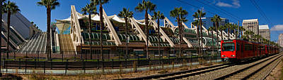 Convention Centers Photograph - Mts Commuter Train Moving On Tracks by Panoramic Images
