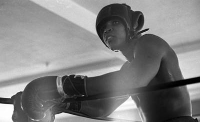 Wall Art - Photograph - Muhammad Ali Gloves Resting On Ropes by Retro Images Archive