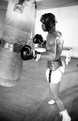 Muhammad Ali Punching The Heavy Bag Art Print by Retro Images Archive