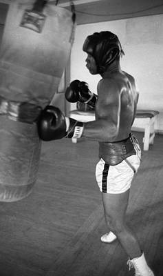 Punching Photograph - Ali Punching Bag by Retro Images Archive