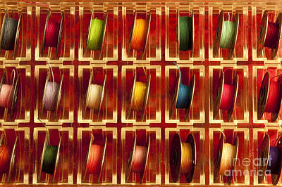 Photograph - Mulitcolored Tray Of Metal Sewing Thread Spools by Jim Corwin