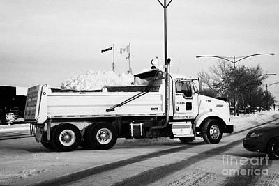 municipal city dump truck taking away snow cleared from parking lots and roads in Saskatoon Saskatch Art Print