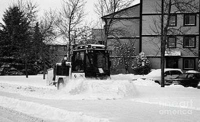 municipal city mini tractor clearing sidewalks and roads in Saskatoon Saskatchewan Canada Art Print