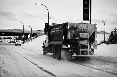 municipal city truck spreading grit and salt on roads in Saskatoon Saskatchewan Canada Art Print