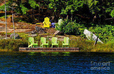Photograph - Muskoka Chairs On A Wooden Dock by Les Palenik