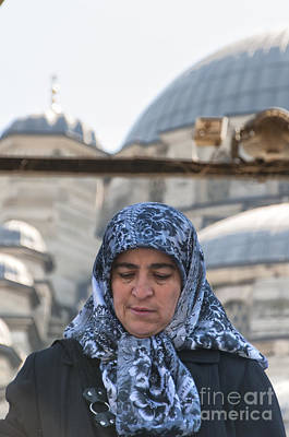 Stellar Interstellar - Muslim woman leaves mosque by Antony McAulay
