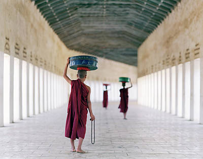 Photograph - Myanmar, Bagan, Monks In Temple Corridor by Martin Puddy