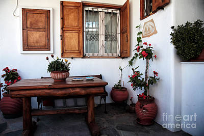 Photograph - Mykonos Flowers On The Patio by John Rizzuto