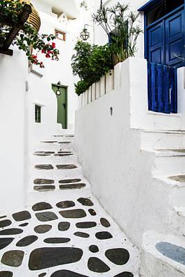 Blue Door Greece Photograph - Mykonos, Greece Rock And Stucco Patio by Jolly Sienda