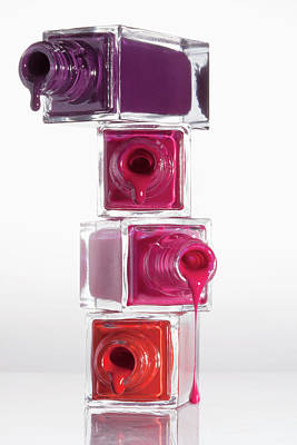 Photograph - Nail Polish Dripping From A Stack Of by Larry Washburn