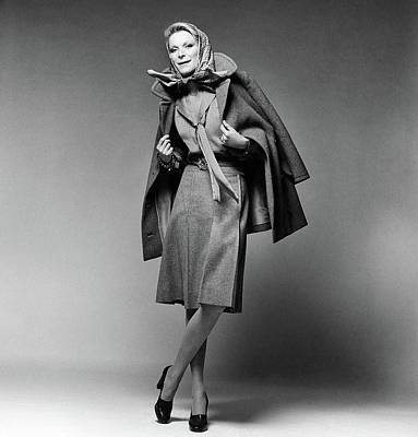 Christian Dior Photograph - Nan Kempner Wearing A Pea Jacket And Skirt by Francesco Scavullo